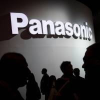Attendees walk past a Panasonic Corp. booth during the 2018 Consumer Electronics Show (CES) in Las Vegas, Nevada, on Jan. 10. | BLOOMBERG