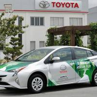 Toyota Motor Corp. unveils a prototype of the world's first hybrid vehicle to run on ethanol, in Brazil on Tuesday.   TOYOTA MOTOR CORP. VIA KYODO
