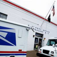 The entrance of a United States Post Office is seen in Manhasset, New York, is seen in 2012.   REUTERS