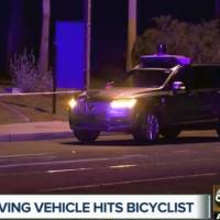 This Monday still image taken from video provided by ABC-15 shows investigators at the scene of a fatal accident involving a self driving Uber car on the street in Tempe, Arizona. Police in Tempe said Monday that the vehicle was in autonomous mode with an operator behind the wheel when the woman walking outside of a crosswalk was hit. | ABC-15.COM / VIA AP
