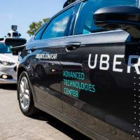 Pilot models of the Uber self-driving car are displayed at the Uber Advanced Technologies Center in Pittsburgh, Pennsylvania, in 2016. Uber said Monday it is cooperating with police following a deadly accident involving one of the ride-share company's self-driving cars in Arizona. | AFP-JIJI