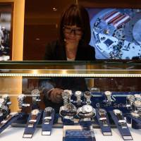 An employee arranges Seiko Watch Corp.'s Grand Seiko brand watches at the company's Seiko Premium Boutique store, in the upscale Ginza shopping district of Tokyo on Feb. 28. | BLOOMBERG