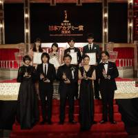 Japanese film's big night: Award winners pose for a picture at what is sometimes referred to as Japan's Oscars, the Japan Academy Film Prizes. Front row from left: Suzu Hirose, Masaki Suda, Hirokazu Kore-eda, Yu Aoi and Koji Yakusho. In the back are: Ayami Nakajo, Minami Hamabe, Takumi Kitamura and Ryoma Takeuchi. | © JAPAN ACADEMY FILM PRIZE ASSOCIATION