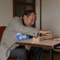 Your move: A still from 'Gokutomo' ('Friends in Prison') shows Iwao Hakamada (left) playing shogi with film director Kim Sung-woong.   COURTESY OF KIMOON FILMS / VIA KYODO