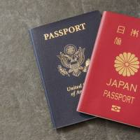 US and Japanese Passport on slate background | GETTY IMAGES