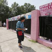 Pam Miller, of Pro Life Mississippi, attempts to counsel a person entering the Jackson Women's Health Organization clinic near downtown Jackson, Mississippi, in 2015. The facility is currently Mississippi's only abortion clinic. | AP