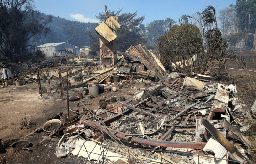 A house thats has been destroyed by a bushfire can be seen near the town of Cobden, located southwest of Melbourne in Australia Sunday. | AAP / DAVID CROSLING / VIA REUTERS