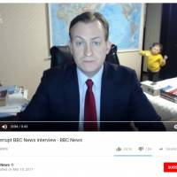 Robert Kelly, an associate professor at Pusan National University, is seen commenting on the downfall of impeached South Korean President Park Geun-hye as his daughter, Marion, enters his home office during a live interview with the BBC last March in this screen shot from YouTube. The incident became a viral sensation that the BBC described as a 'perfect piece of physical comedy.'