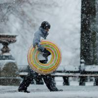 A pedestrian walks through Central Park during a snow storm in New York Wednesday.   REUTERS