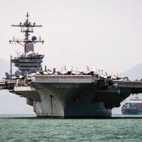 State-run Global Times says China unhappy over U.S. carrier visit to Vietnam
