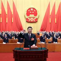 China propaganda kicks into overdrive as 'helmsman' Xi basks in glow of presidential reappointment