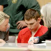 FILE PHOTO: Nikolas Cruz, facing 17 charges of premeditated murder in the mass shooting at Marjory Stoneman Douglas High School in Parkland, appears in court for a status hearing in Fort Lauderdale, Florida, Feb. 19.   REUTERS