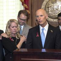 Florida governor signs gun restrictions