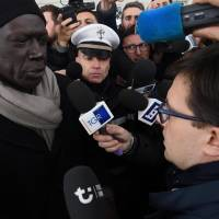 Senegalese spokesman Pape Diaw (left) talks with Florence Mayor Dario Nardella during a demonstration at Vespucci bridge in Florence, Italy, Tuesday. | CLAUDIO GIOVANNINI / ANSA / VIA AP