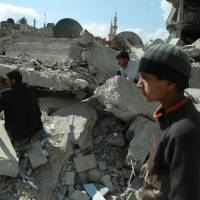 Airstrikes have eased in Syria's Ghouta but rescuers keep finding bodies in the rubble
