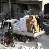 Aid convoy quits embattled Syrian enclave of Douma as regime presses onslaught