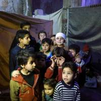 Rebels and civilians flee to last remaining pockets of Ghouta as Syria regime closes pincers