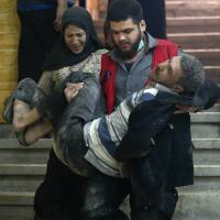 Sick and injured start leaving Syria's besieged Ghouta under rare medical evacuation
