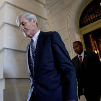 Former FBI Director Robert Mueller, the special counsel probing Russian interference in the 2016 election, departs Capitol Hill following a closed-door meeting in Washington last June. President Donald Trump is questioning the impartiality of Mueller's investigation and says the probe is groundless, while raising doubts about whether a fired top FBI official kept personal memos outlining his interactions with Trump. | AP