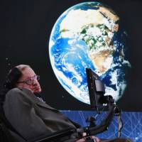 Physicist Stephen Hawking sits on stage during an announcement of the Breakthrough Starshot initiative with investor Yuri Milner in New York on April 12, 2016. | REUTERS