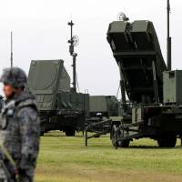 A Self-Defense Forces soldier takes part in a drill to mobilize a Patriot Advanced Capability-3 (PAC-3) missile unit in response to a recent missile launch by North Korea, at the U.S. Air Force's Yokota Air Base in Fussa, on the outskirts of Tokyo, last August. | REUTERS