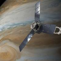 An illustration depicts the U.S. space agency's Juno spacecraft in orbit above Jupiter's Great Red Spot. | NASA / JPL-CALTECH / HANDOUT / VIA RREUTERS