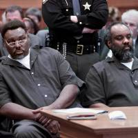 In this 2000 photo (from left) Nathaniel and Anthony Cook sit during their sentencing at Lucas County Courthouse in Toledo, Ohio. Nathaniel Cook, one of two brothers who admitted killing a 12-year-old girl during a string of murders in the early 1980s, could get out of prison within months. Nathaniel admitted he took part in three of those slayings with his brother, Anthony, who's now serving two life sentences. A judge has set a hearing for Thursday to begin determining whether Cook should be registered as a sex offender if he's released. | LORI KING / THE BLADE / VIA AP