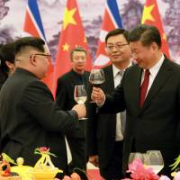 North Korean leader Kim Jong Un toasts with Chinese President Xi Jinping during an unofficial visit to Beijing in this undated photo released Wednesday. | KCNA/VIA REUTERS