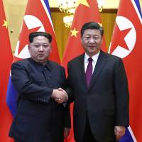 North Korean leader Kim Jong Un and Chinese President Xi Jinping shake hands in Beijing in this photo provided Wednesday. The Chinese government has confirmed that Kim visited Beijing and met with Xi in his first known trip to a foreign country since he took power in 2011. | AP