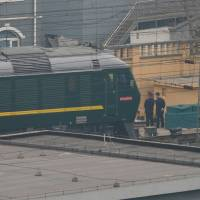 A train believed to be carrying a senior North Korean delegation leaves the Beijing Railway Station Tuesday. | REUTERS
