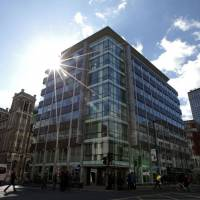 The shared building that houses the offices of Cambridge Analytica are pictured in central London on Wednesday. The academic behind the app that harvested data from 50 million Facebook users said Wednesday he was being used as a scapegoat in the row over online privacy. Aleksandr Kogan said that British firm Cambridge Analytica, which is at the center of a major scandal rocking Facebook, assured him that what he was doing was 'perfectly legal and within the terms of service' of the social media giant. | AFP-JIJI