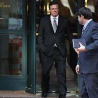 Paul Manafort (left), President Donald Trump's former campaign chairman, and his wife, Kathleen Manafort, walk behind spokesman Jason Maloni as they leave the Alexandria Federal Courthouse after an arraignment hearing in Alexandria, Virginia, Thursday. | AP