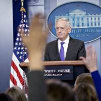 U.S. Secretary of Defense Jim Mattis listens to a question during a White House news briefing in Washington in February. | BLOOMBERG