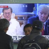 A TV at Seoul Station broadcasts news of the phone call between President Moon Jae-in and U.S. President Donald Trump on Friday. | AP