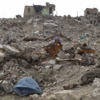 In this frame grab from video, bodies lie among the rubble in the Maydan district of Mosul's Old City, Iraq, Wednesday. Dozens of bodies of alleged Islamic State group fighters continue to litter Mosul's Old City some eight months after Iraq declared victory over the extremists there. | AP