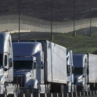 Trucks line up to cross the border to the United States at the Otay Mesa Commercial Port of Entry in Tijuana, Mexico, on Jan. 22. | AFP-JIJI
