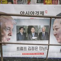 A newspaper on sale at a Seoul newsstand Friday features images of U.S. President Donald Trump, North Korean leader Kim Jong Un and South Korean National Security Council chief Chung Eui-yong.   BLOOMBERG