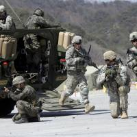 U.S. Army and South Korean soldiers take positions during the annual Foal Eagle joint military exercise at the Rodriquez Multi-Purpose Range Complex in Pocheon, South Korea, in March 2015.   AP