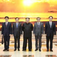 North Korean leader Kim Jong Un meets members of the special delegation of South Korean President Moon Jae-in in this photo released Tuesday. | KCNA/VIA REUTERS