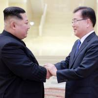 North Korean leader Kim Jong Un greets Chung Eui-yong, head of the South Korean presidential National Security Office, in Pyongyang in this photo released Tuesday. | PRESIDENTIAL BLUE HOUSE / YONHAP / VIA REUTERS