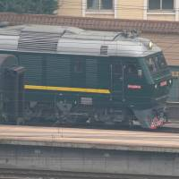 A train believed to be carrying a senior North Korean delegation leaves the Beijing Railway Station on Tuesday. | REUTERS