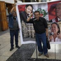 A man fed up with politics decries Peruvian politicians minutes after President Pedro Pablo Kuczynski delivered a nationwide televised address to announced he had offered his resignation to Congress, in Lima Wednesda. Kuczynski offered up his resignation ahead of an impeachment vote scheduled for Thursday, citing unjustified attacks by opponents that made it impossible to govern. | AP