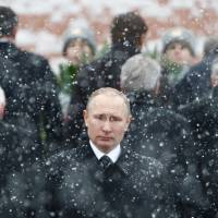 Putin has Russia guessing before election: How long will he keep power?