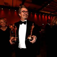 Gary Oldman holds his Oscar for Best Actor and Frances McDormand's Oscar for Best Actress at the 90th Academy Awards Oscars Governors Ball in Hollywood, California, Sunday.   REUTERS