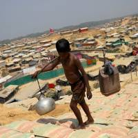 U.N. in talks with Bangladesh about relocating Rohingya to safe areas as monsoon looms