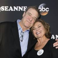 Actor John Goodman and actress/executive producer Roseanne Barr attend The Roseanne Series Premiere at Walt Disney Studios in Burbank, California, March 23. Hit U.S. working-class comedy 'Roseanne' returns after a two-decade hiatus with the eponymous star now a pill-popping, Trump-voting grandmother winning largely positive reviews in a sharply polarized America. | AFP-JIJI