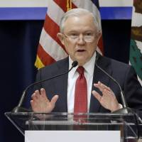 U.S. Attorney General Jeff Sessions addresses the California Peace Officers' Association 26th Annual Law Enforcement Legislative Day Wednesday in Sacramento. The Trump administration on Tuesday sued to block California laws that extend protections to people living in the U.S. illegally. | AP