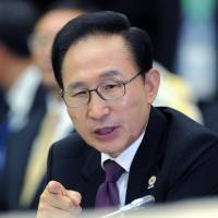 Former South Korean President Lee called in for questioning in bribery case