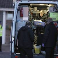 Police in Salisbury, England, Wednesday work around the home of former Russian double-agent Sergei Skripal. The Russian ex-spy and his daughter are fighting for their lives in an English hospital after they were attacked Sunday with a nerve agent in a targeted murder attempt, British police said Wednesday. | ANDREW MATTHEWS / PA / VIA AP