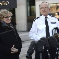 Head of counterterrorism police Assistant Commissioner Mark Rowley and England's chief medical officer, Dame Sally Davies, speak outside New Scotland Yard, central London, giving an update Wednesday on the ongoing incident after former Russian double-agent Sergei Skripal and his daughter, Yulia, were found critically ill by exposure to an unknown substance in Salisbury, England, on Sunday. | KIRSTY O'CONNOR / PA / VIA AP